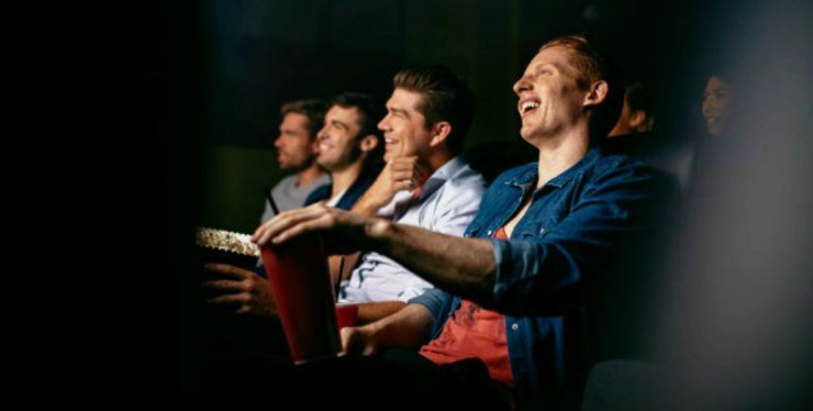 Group of friends watching movie   Surviving Sleep Deprivation
