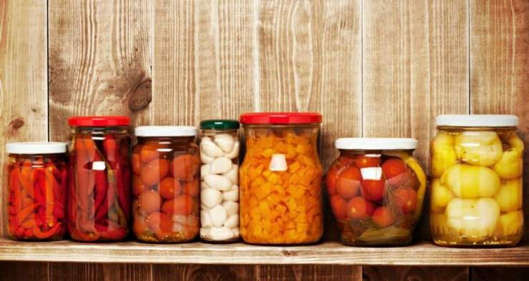 Marinated food in glass jars on a wooden shelf | Canning Jar | How To Guide To Canning