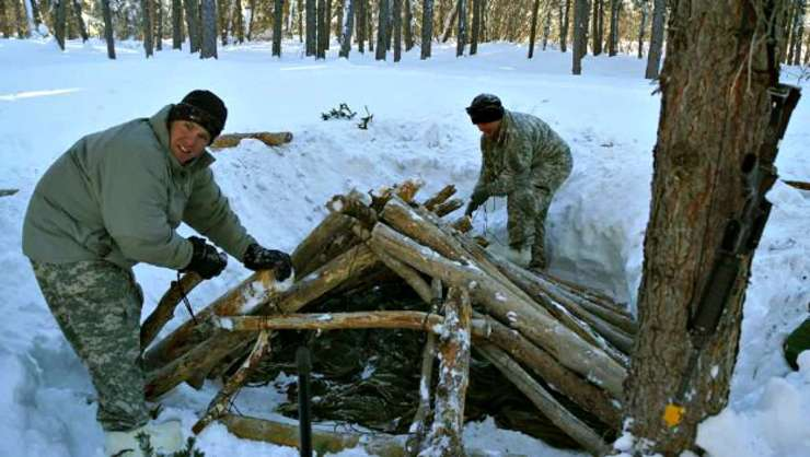 Two men building shelter | Snow Survival Shelter