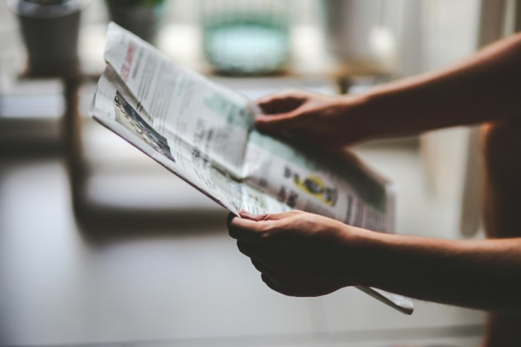 man reading newspaper   Multipurpose Items For Survival You Need To Stock Up On   multipurpose items for survival