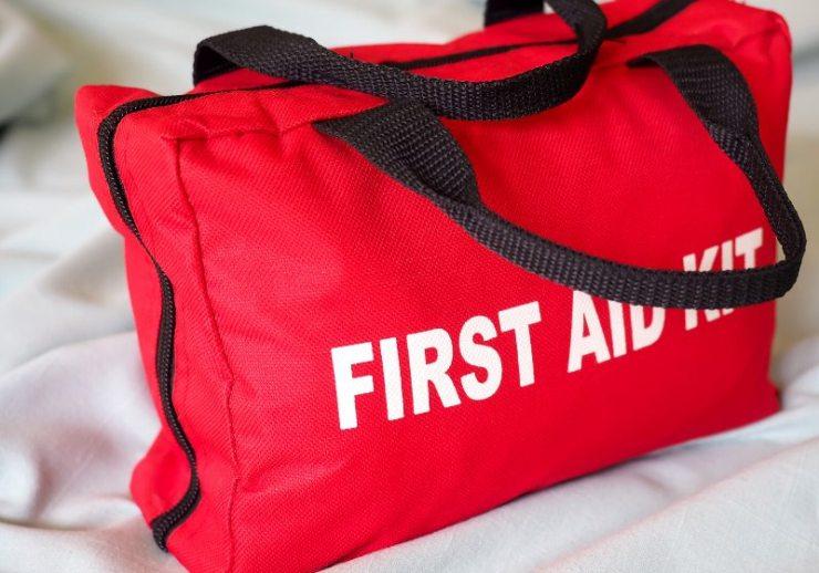 first aid kit closeup bag against | prepper supplies wholesale