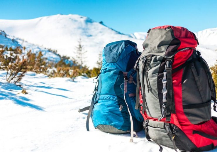 two backpacks background snowcapped mountains blue | survival supplies