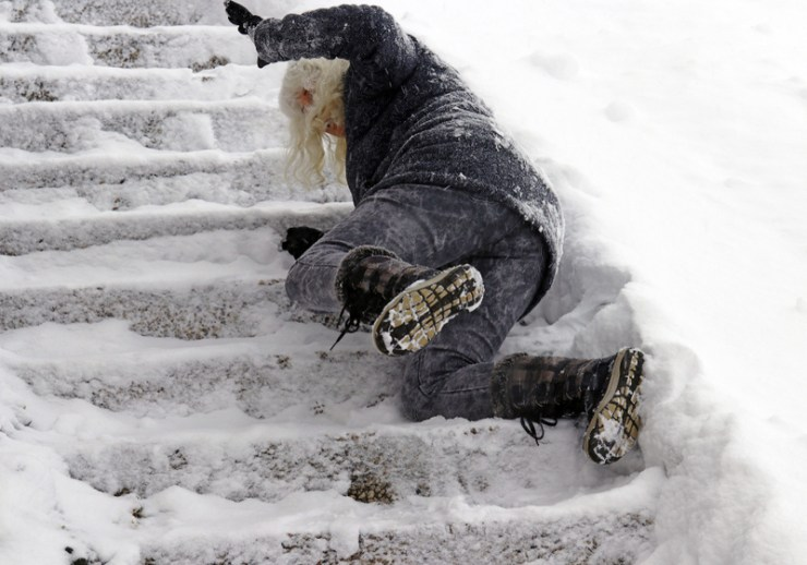 A woman slipped and fell on a wintry staircase. Fall on smooth steps | avoid icy stairs and ramps
