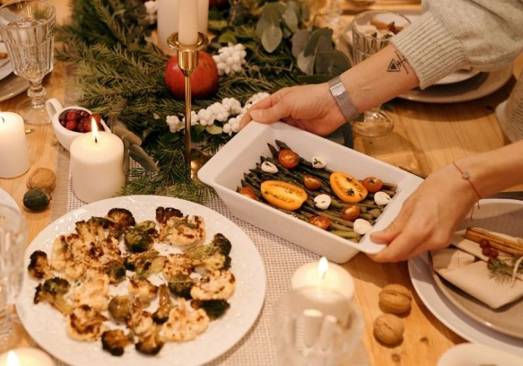 Person serving a food on christmas dinner | Christmas Survival Guide | How to Survive Christmas
