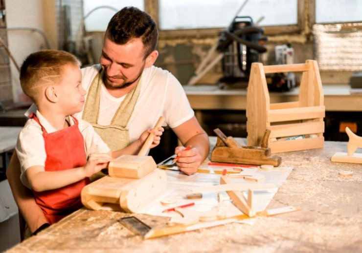 dad son carpenters shop make wooden | new year health tips