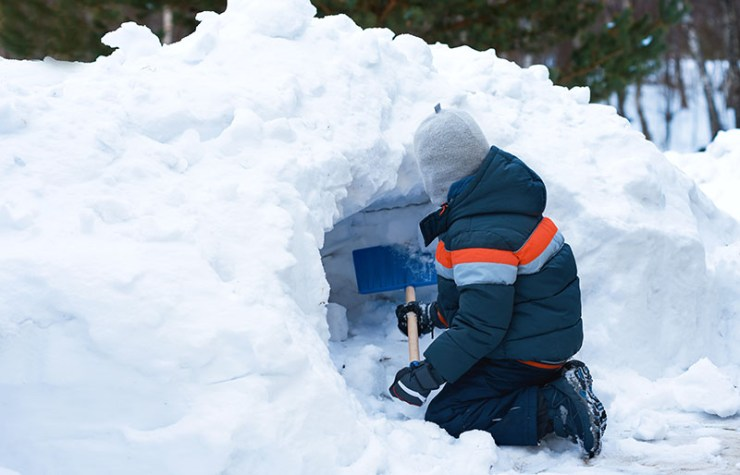 european boy making snow cave | how to build a quinzee