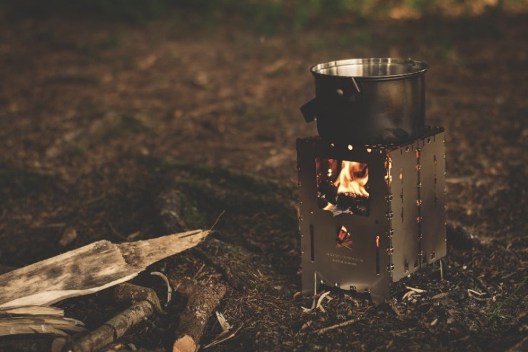 stainless-steel-pot-on-brown-wood-stove-outside-during-night-time-px _ potable water