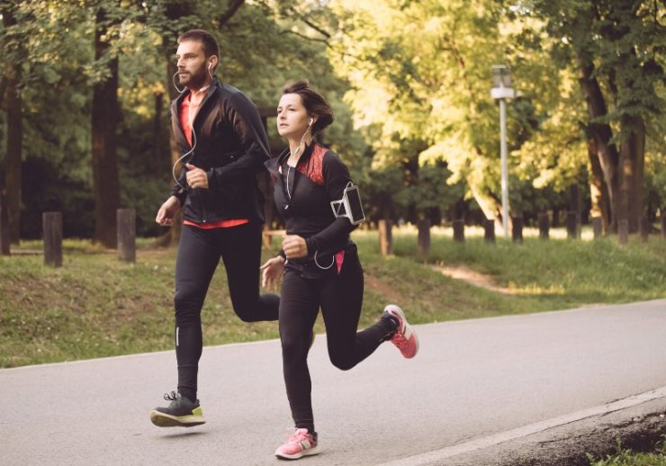young couple running together park | my new year resolution