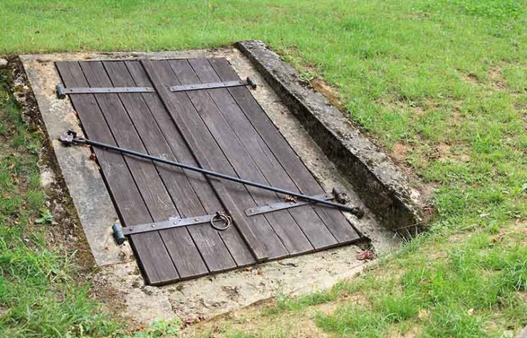 old closed wooden entrance underground cellar | how to build a bunker