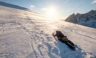 Snowy hill in blizzard at sunset | Winter First Aid Guide | Surviving The Cold Weather | Featured