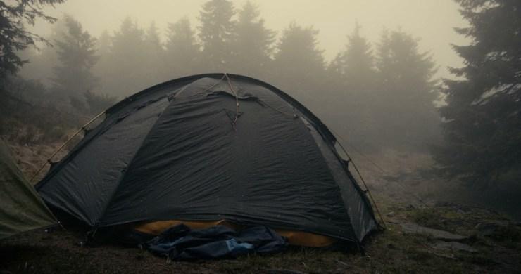 Spherical touristic tent under flowing snowflakes in the Carpathians | Military perimeter alarm