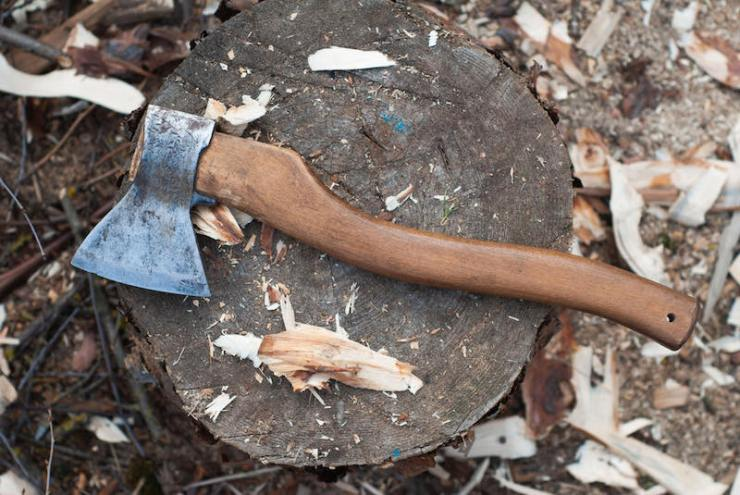 axe lying on a log | Bow drill definition