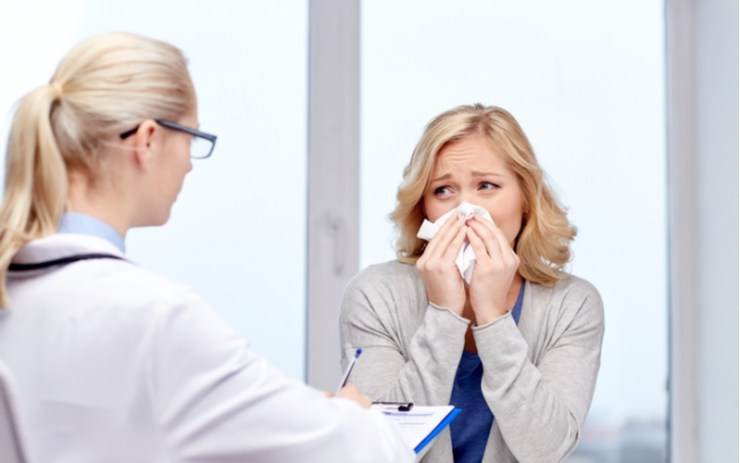 doctor and ill woman patient with flu at clinic | spring allergies | Consult your doctor