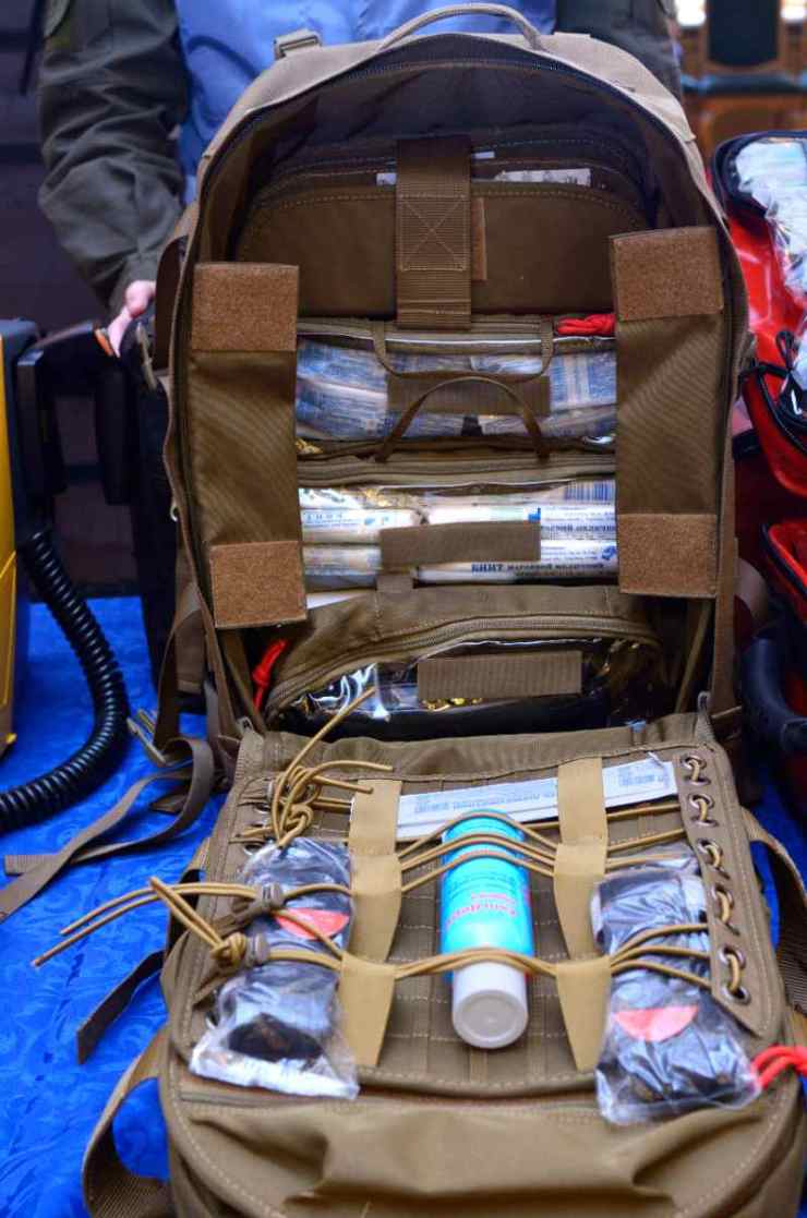 Backpack with soldier s first aid kit bandages, wound-healing drugs, balloon with burn-treating gel, painkillers-IFAK