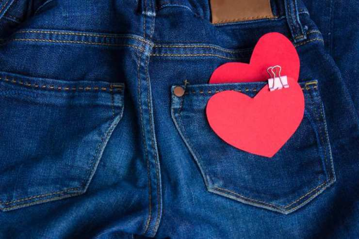 Blue jeans pants with hearts in back pocket. Valentines Day concept-binder clips