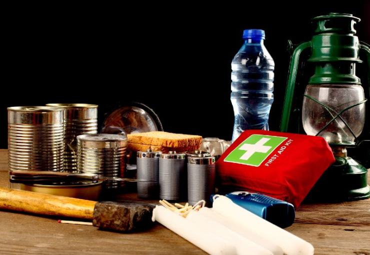 Items for emergency on wooden table-BUDGET SURVIVAL KIT