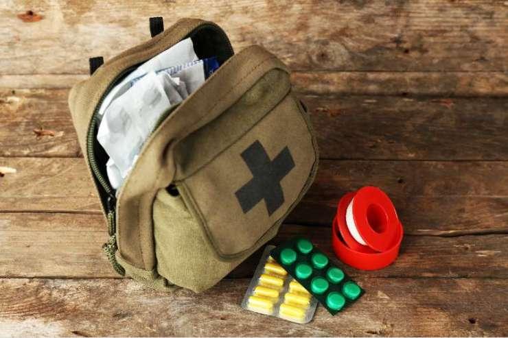 Medicine chest on wooden background-ifak