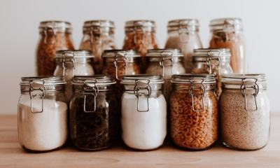 Air tight glass jars filled with rice and pasta and basic ingredients | Basic Survival Food Storage On a Budget | featured