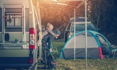 Camping Family Time. Father Playing with His Daughter Around Camper Van RV and Tents | RVing and Prepping - Something to Think About | featured