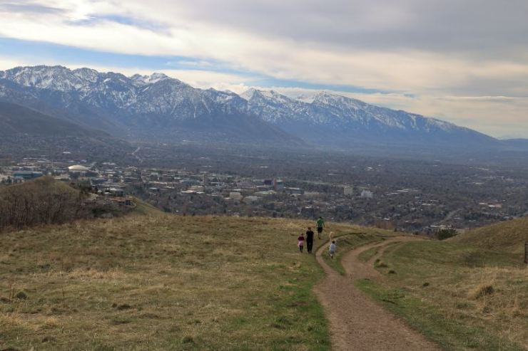 Family on a stroll in the foothills of the Wasatch enjoying views of downtown Salt Lake City-best hiking trails