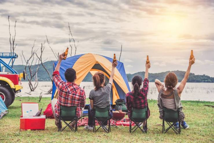 Group of Young Asian Camper Enjoy Camping Outdoors Party with Friends Near the Lake in the Forest-Camping In The Rain