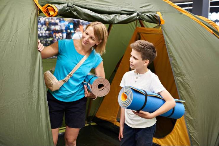 Mom and son choose a camping tent in store | camping tent | featured