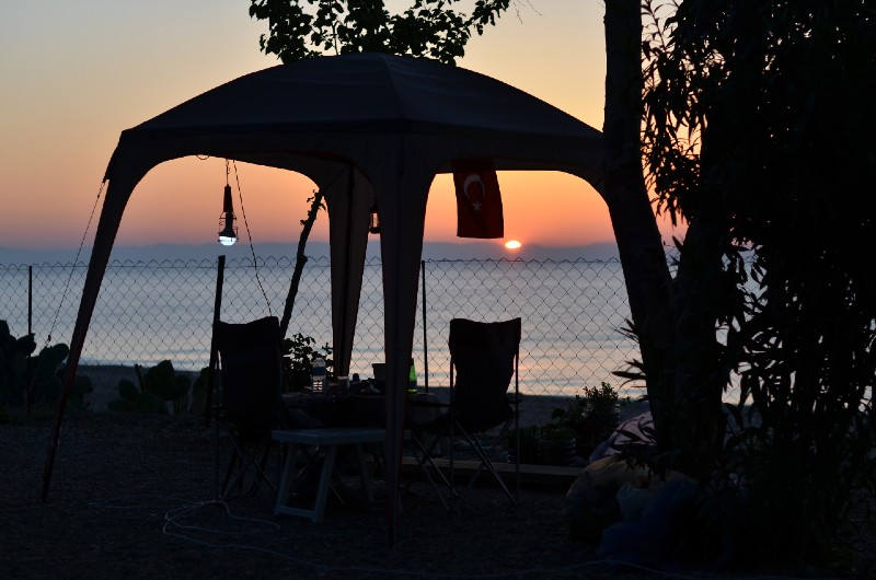 Romantic dinner in a tent on a sandy beach at sunset-Camping In The Rain