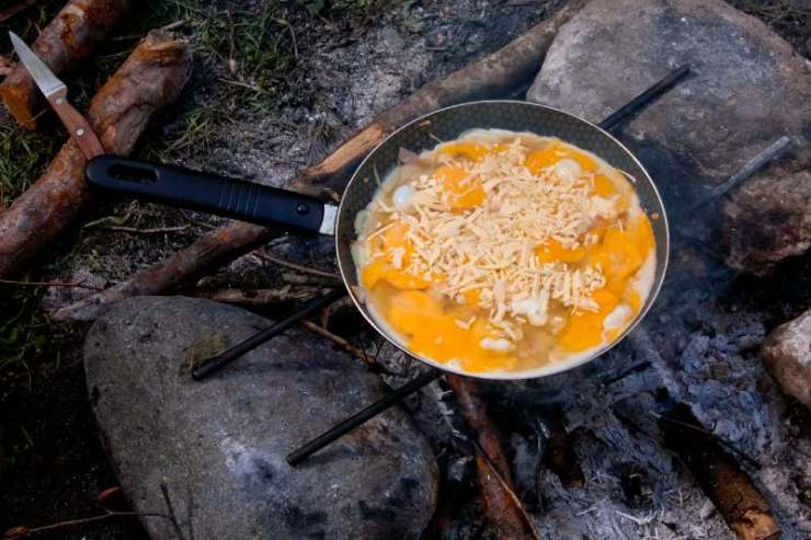 Scrambled eggs cooked on picnic fire-classic camping food