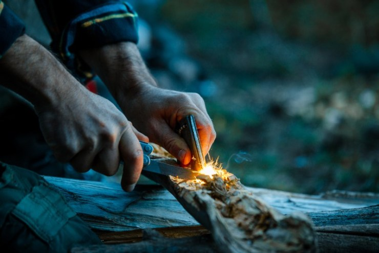 Starting A Campfire With A Fire Striker While Wilderness Camping-campfire