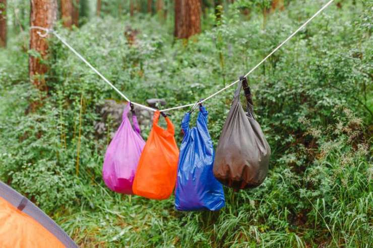 Waterproof dry bags in camping in mountains-Camping In The Rain