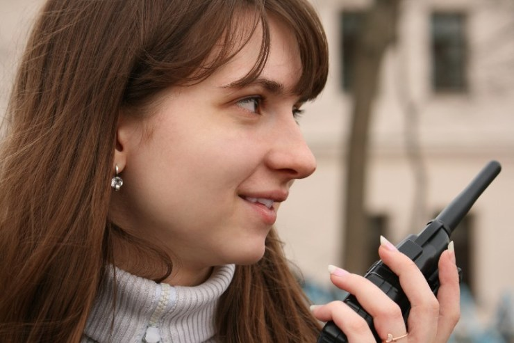 Girl with portable radio transmitter - emergency radios