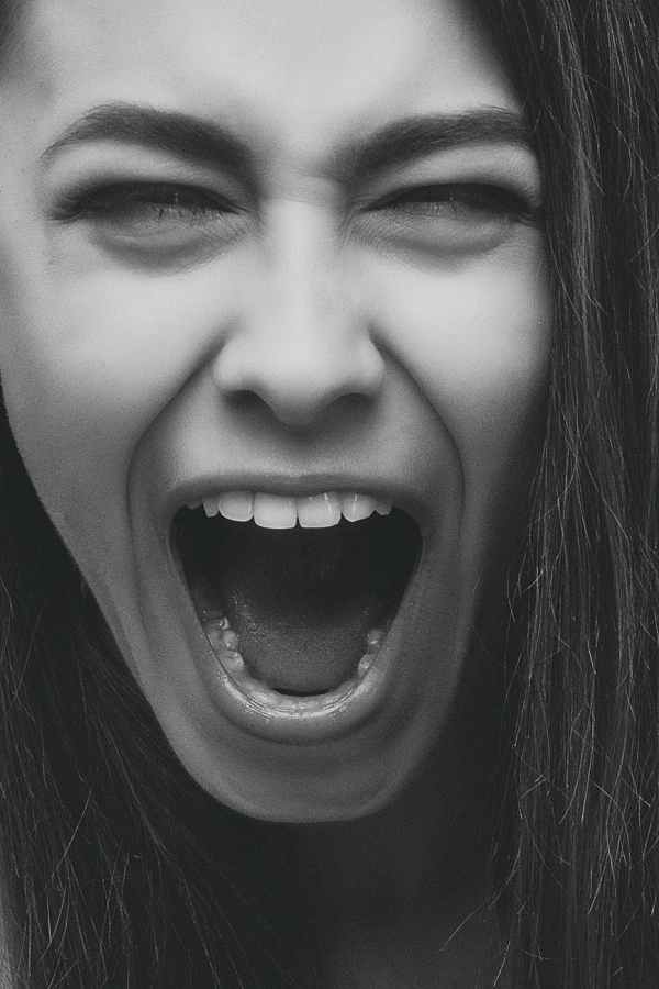 grayscale photo of person screaming