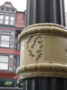 Light post with Susan's image near the site where she voted in 1871. Photo by Jeanne Gehret