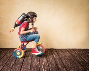 46594773 - kid with jet pack riding bike. child playing at home. success, leader and winner concept