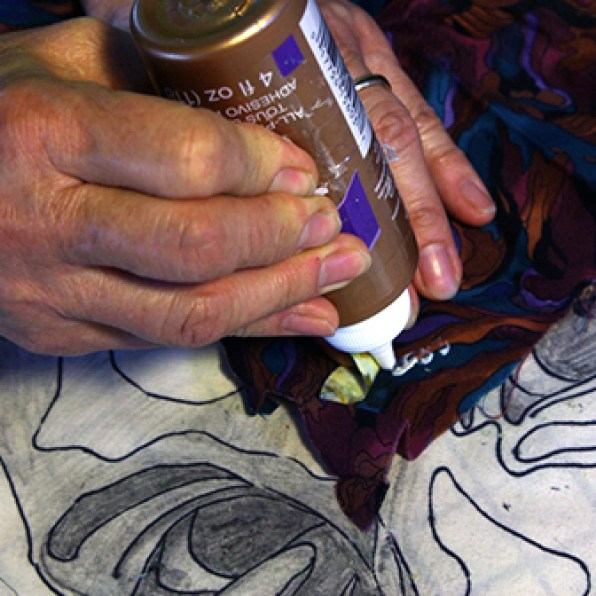 Glue iris+whites section to new fabric.