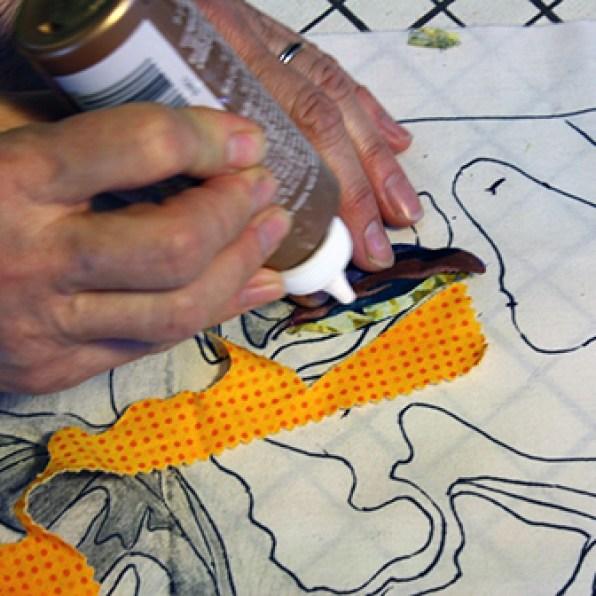 Glue eye to new fabric.