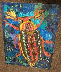 A previous year's class project turned floor cloth by Joan.