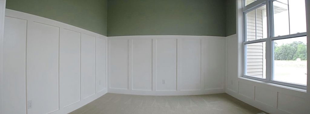 Main level office or 2nd bedroom. Wainscot detail on walls.
