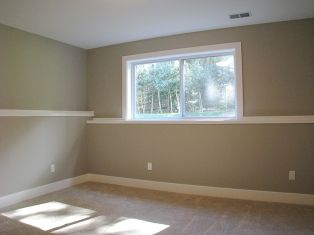 Another view of carpeted lower level bedroom.