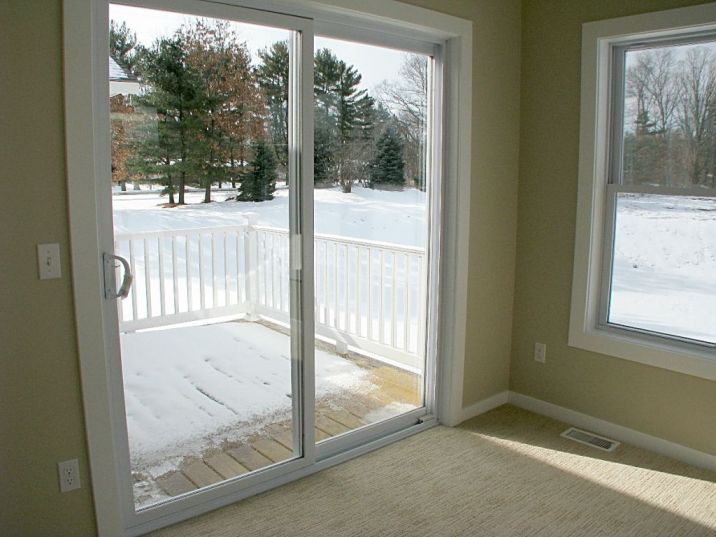 Slider from 4-season room to backyard deck