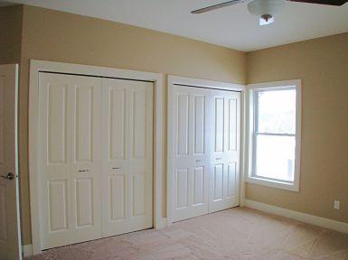 Two double 4-panel bi-fold closet doors in master bedroom