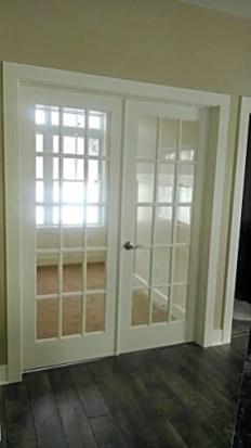 Double glass pane french doors to 4-season room.