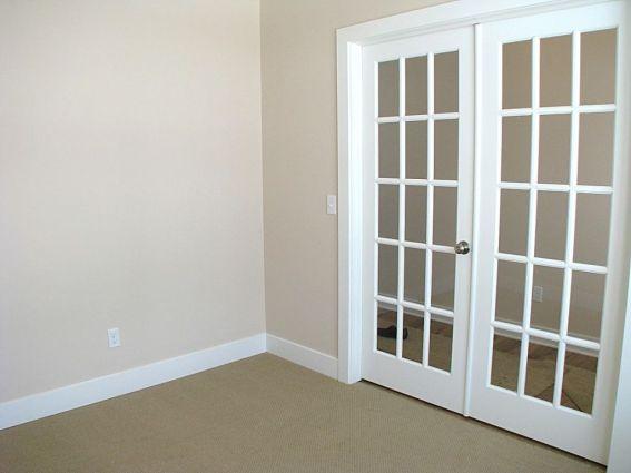 Office, den, or bedroom. Glass panel French doors.