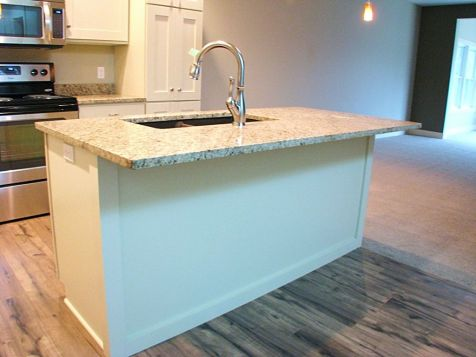 Snack bar with hard surface counter, high rise faucet & snack bar
