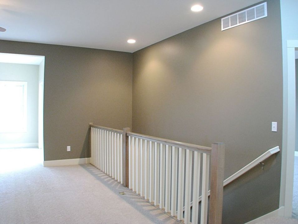Open stairway with spindle railing leading to the lower level