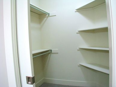 Walk-in master bedroom closet with organizers