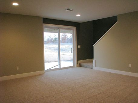 Lower level family room with slider to back patio