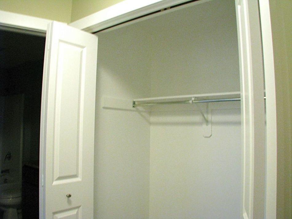 Lower level closet with bi-fold double door closet