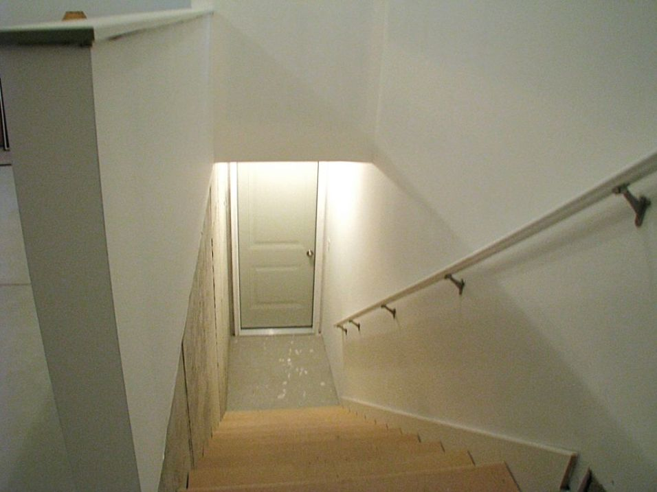 Close up of the stairway of the stairway from the garage to the lower level
