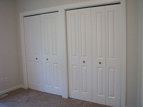 2430 Two master bedroom closets with 4 panel bi-fold doors